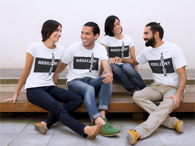 Co-ed group of people wearing Resilient Together white t-shirts with black print