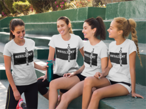 Group of women on a tennis court wearing white Resilient Together t-shirts