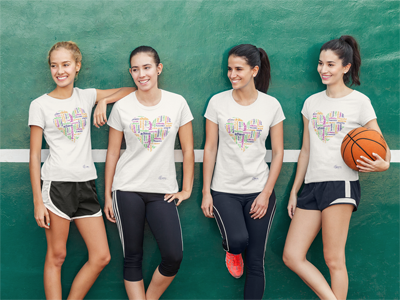 Group of women wearing the white heart t-shirt on a basketball court