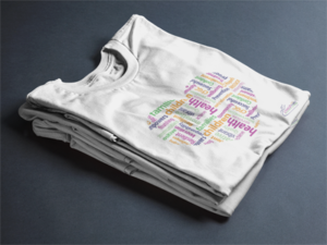Stack of folded white heart t-shirts from CFGC